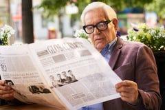 Senior Man Reading Newspaper Stock Photos