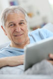 Portrait of modern senior man using tablet Royalty Free Stock Photo
