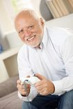 Portrait of modern senior playing computer game Stock Photos
