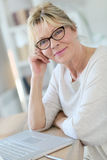 Portrait of modern senior woman using laptop Royalty Free Stock Image