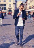 Portrait of modern young man with mobile phone in the street. Outdoor portrait of modern young man with mobile phone in the street Stock Photo