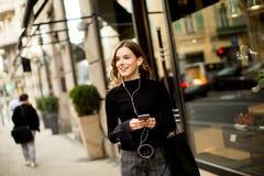 Modern young shopaholic woman on street Royalty Free Stock Photo