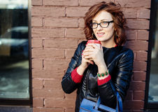 Portrait of a modern young woman with coffee cup Stock Images
