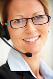 Portrait of a modern young woman using headset Stock Photography
