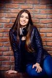 Girl wears black jacket stock image