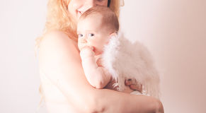 Portrait of mom with her baby angel Stock Photo