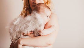 Portrait of mom with her baby angel Stock Images