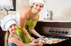 Portrait of mom and kid with pizza Royalty Free Stock Image