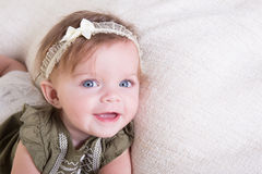 Portrait of a 6 month old baby girl on white stock images