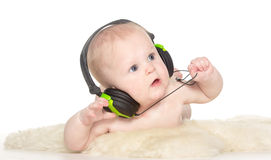 Portrait of 6 month old boy with headphones Stock Photos