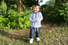 Portrait of 20 months baby boy walking in summer Stock Photo