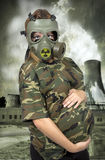 Portrait of 9 months pregnant woman in gas-mask Royalty Free Stock Photography