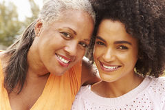 Portrait Of Mother With Adult Daughter In Park Stock Photo