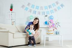 Portrait of mother and baby with birthday cake Stock Image