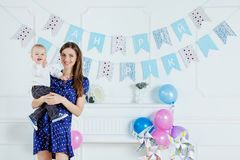 Portrait of mother and baby with birthday cake Stock Images