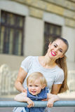 Portrait of mother and baby in city Stock Images