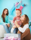 Portrait of a mother with baby daughter and teen daughter near t Royalty Free Stock Photos