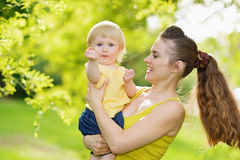 Portrait of mother and baby girl outdoors in park Stock Images