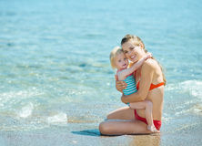 Portrait of mother and baby girl at seaside Royalty Free Stock Image