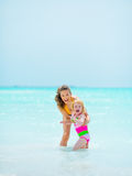 Portrait of mother and baby girl at seaside Royalty Free Stock Photography