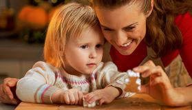 Mother and baby making christmas cookies Royalty Free Stock Photography