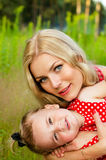 Portrait of mother with baby on nature background Stock Photography