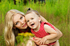 Portrait of mother with baby on nature background summer Stock Images