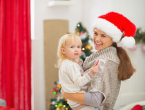 Portrait of mother and baby near Christmas tree Royalty Free Stock Photos