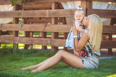 Portrait of mother with baby in summer green park. Outdoors. Stock Photo