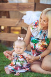 Portrait of mother with baby in summer green park. Outdoors. Royalty Free Stock Images