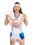 Portrait of mother and baby in tennis clothes Stock Photo