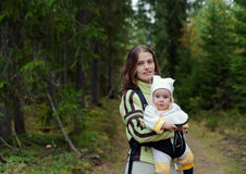 Portrait of Mother and Baby in the wild forest. Royalty Free Stock Photo
