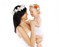 Portrait mother and child with flower wreaths Royalty Free Stock Photos