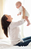 Portrait of mother and child laughing and playing Royalty Free Stock Images