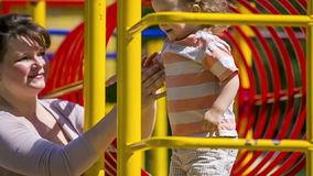Portrait of Mother And Child On the Playground stock video