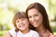 Portrait Of Mother And Child Relaxing In Park Stock Photography
