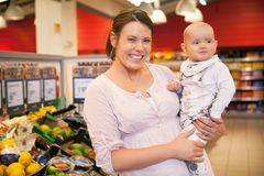 Portrait of Mother and Child in Store Stock Images