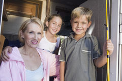 Portrait of mother and children in camper van stock image