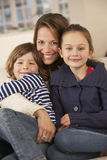 Portrait mother and children at home Royalty Free Stock Images