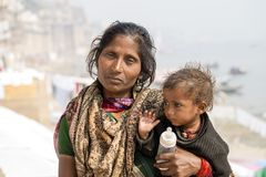 Portrait mother and children on the street in Varanasi, India. VARANASI, INDIA - JANUARY 26, 2017 : Portrait mother and children on the street at the ghats of Stock Images