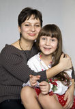 Portrait of mother and daughter. Family portrait. Mother hugging little daughter in his lap Royalty Free Stock Photos