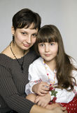 Portrait of mother and daughter. Family portrait. Mother hugging little daughter in his lap Stock Photos