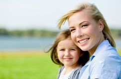 Portrait of mother and daughter against the nature view royalty free stock photo