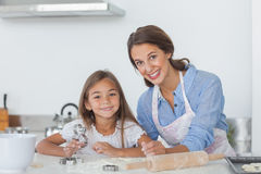 Portrait of mother and daughter baking together Stock Photos