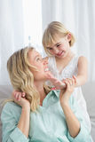 Portrait of a mother and daughter behind her on the couch Royalty Free Stock Image