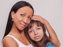 Portrait of a mother and daughter, family hug Stock Photos