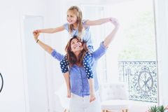 Portrait of mother and daughter having fun together at home. Mother and daughter having fun together at home, smiling caucasian family portrait Stock Photography