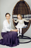 Portrait of mother and daughter at home, happy Stock Image