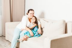 Portrait of mother and daughter at home. stock photo