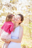 Portrait of mother and daughter kissing Royalty Free Stock Images